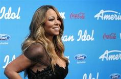 "Judge Mariah Carey poses at the party for the finalists of the television show ""American Idol"" in Los Angeles, California March 7, 2013. REUTERS/Mario Anzuoni"