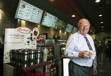 Tim Hortons Inc interim Chief Executive Paul House poses for a portrait at a Tim Hortons coffee shop in Toronto in this July 12, 2012 file photo. REUTERS/Mark Blinch/Files