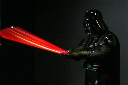 A man dressed as Star Wars character Darth Vader poses for photographers at the ''Star Wars: Where Science Meets Imagination'' exhibition at the Powerhouse Museum in Sydney December 3, 2008. REUTERS/Daniel Munoz