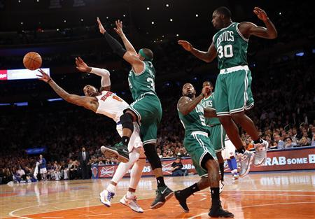 New York Knicks' J.R. Smith (L) tries to pass as he is defended by Boston Celtics' Paul Pierce(2nd from L) in the fourth quarter in Game 5 of their NBA Eastern Conference basketball playoff series in New York, May 1, 2013. At far right is Celtics' Brandon Bass and second from right is Celtics' Jeff Green. The Celtics won the game 92-86. REUTERS/Mike Segar