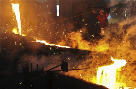 An employee works at a steel factory in Dalian, Liaoning province, May 1, 2013. REUTERS/China Daily