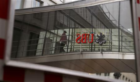 The logo of Swiss bank UBS is reflected in a traffic mirror in Zurich April 30, 2013. REUTERS/Arnd Wiegmann