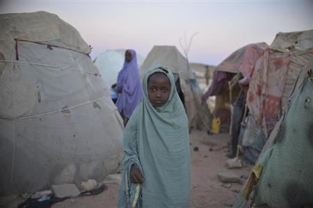 A girl stands in a camp for internally displaced persons (IDP) on the outskirts of Belet Weyne, about 315 km (196 miles) from the capital Mogadishu, February 20, 2013, in this picture provided by the African Union-United Nations Information Support (AU-UN IST) team. REUTERS/Tobin Jones/AU-UN IST PHOTO/Handout (SOMALIA - Tags: SOCIETY POLITICS)