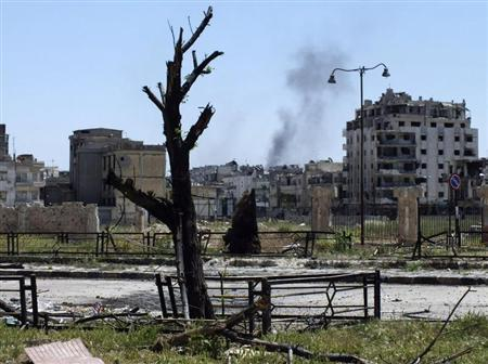 Smoke rises after what activists said was shelling by forces loyal to Syria's President Bashar al-Assad in Homs April 29, 2013. Picture taken April 29, 2013. REUTERS/Yazan Homsy