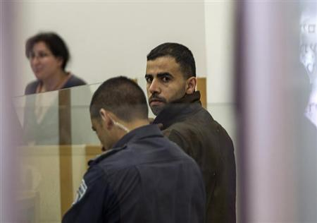 Hikmat Massarwa (R), a member of Israel's Arab minority, attends a remand hearing at the Central District Court in Lod, near Tel Aviv April 25, 2013. REUTERS/Baz Ratner