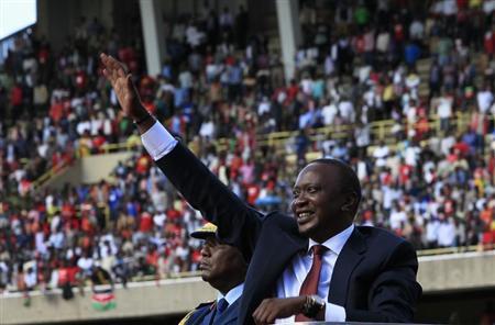 Kenya's President Uhuru Kenyatta (R) waves as he leaves after his swearing-in ceremony at Kasarani Stadium in the capital Nairobi, April 9, 2013. REUTERS/Noor Khamis
