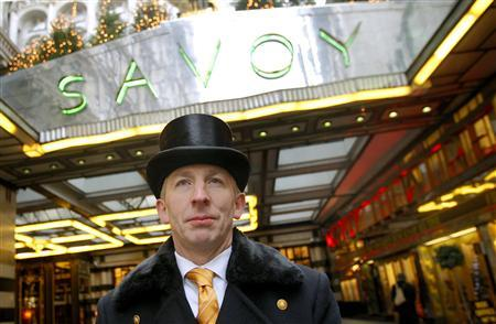 Doorman at the Savoy Hotel for the past twenty eight years, Peter Maglin, stands on duty in central London, December 17, 2007. REUTERS/Toby Melville