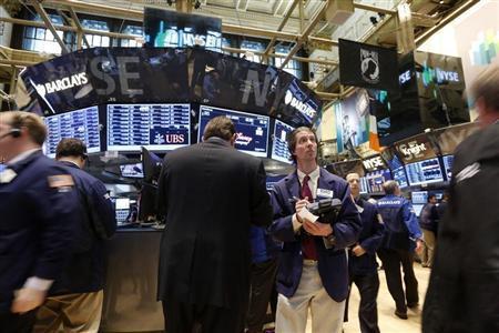 Traders work on the floor at the New York Stock Exchange, April 30, 2013. REUTERS/Brendan McDermid