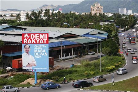 A campaign poster of Malaysia's opposition leader Anwar Ibrahim is on display ahead of the general elections in Bukit Mertajam, 350 km (217 miles) north of Kuala Lumpur in this April 19, 2013 file picture. REUTERS/Samsul Said/Files (M