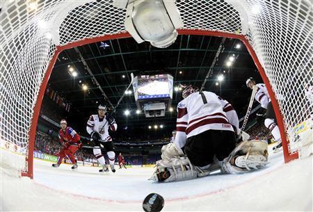 Russia's Ilya Kovalchuk (L) scores past Latvia's goalie Maris Jucers during their 2013 IIHF Ice Hockey World Championship preliminary round match at the Hartwall Arena in Helsinki May 4, 2013. REUTERS/Alexey Kudenko/RIA Novosti/Pool