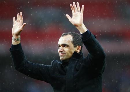 Wigan Athletic's manager Roberto Martinez waves after their FA Cup semi-final soccer match against Millwall at Wembley Stadium in London, April 13, 2013. REUTERS/Darren Staples