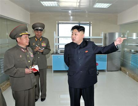 North Korean leader Kim Jong-un (R) visits the Turf Institute of the Bioengineering Branch under the State Academy of Sciences in Pyongyang, in this picture released by North Korea's KCNA news agency May 6, 2013. REUTERS/KCNA