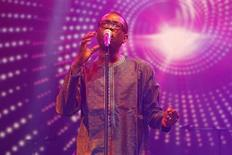 """Singer Youssou N'Dour performs at a concert called """"Africa Celebrates Democracy"""" that pays tribute to Tunisian youth and the revolution that inspired the Arab Spring, in Tunis November 11, 2011. REUTERS/Anis Mili"""