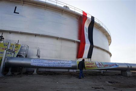 An employee of the state-run South Oil Company (SOC) walks near a new oil storage tank near the southern city of Basra January 14, 2013. REUTERS/Atef Hassan