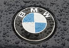 The logo of German car manufacturer BMW is seen on the bonnet of a vehicle covered with water drops in Kiev March 27, 2012. REUTERS/Str