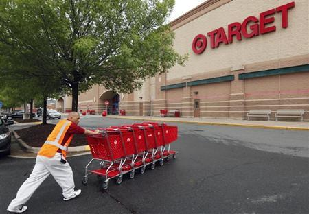 A Target employee returns carts to the store in Falls Church, Virginia May 14, 2012. Target Corp. (TGT) will report its first quarter results on May 16th. REUTERS/Kevin Lamarque
