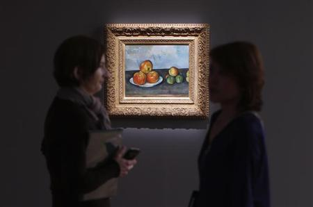 Visitors talk near Paul Cezanne's 'Les Pommes,' estimated between $25-35 million, during a preview of Sotheby's May 7 Impressionist and Modern Art Evening Sale at Sotheby's in New York, May 3, 2013. REUTERS/Mike Segar