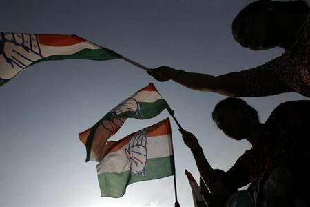 Supporters of Congress wave party flags at an election rally in Bangalore May 7, 2008. REUTERS/Arko Datta/Files