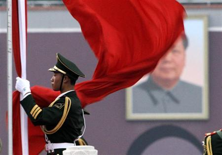 A paramilitary policeman prepares for a national flag-lowering ceremony in front of a portrait of the late chairman Mao Zedong on Tiananmen Square in Beijing, August 17, 2010. REUTERS/Jason Lee