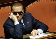 Экс-премьер Италии Сильвио Берлускони на сессии сената в Риме 16 марта 2013 года. Миланский апелляционный суд в среду подтвердил приговор 76-летнему Берлускони - четыре года тюрьмы за мошенничество с налогами в связи с покупкой прав на вещание для его телевизионной сети Mediaset. REUTERS/Remo Casilli