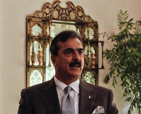 Former Pakistan Prime Minister Yusuf Raza Gilani speaks during an interview with Reuters at his residence in Islamabad September 27, 2011. REUTERS/Mian Khursheed/Files
