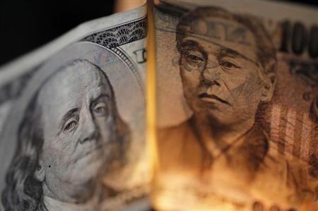 5月9日、日銀の「異次元緩和」のインパクトがかすみ始めるなかで、ドル/円の100円回復が一段と遠のいている。写真は2010年、都内で撮影(2013年 ロイター/Yuriko Nakao)