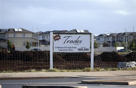 A sign near the Trades housing division built by Gentry Homes promotes special offers for potential buyers in Ewa Beach, Hawaii, March 6, 2013. REUTERS/Hugh Gentry