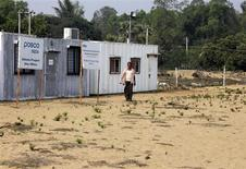 A villager walks at the POSCO India Odisha Project site office at Gobindpur village in Jagatsinghpur district, in the eastern Indian state of Odisha, February 7, 2013. REUTERS/Stringer