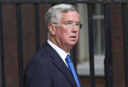 MP Michael Fallon arrives at Downing Street in London, September 4, 2012. REUTERS/Neil Hall