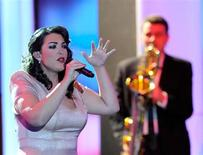 """Dutch singer Caro Emerald performs after being awarded in category """"Best International Music Artist"""" during the 47th Golden Camera award ceremony in Berlin February 4, 2012. REUTERS/Maurizio Gambarini/Pool"""