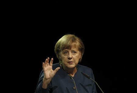 German Chancellor Angela Merkel gestures as she gives a speech at the German sustainable development congress in Berlin, May 13, 2013. REUTERS/Fabrizio Bensch