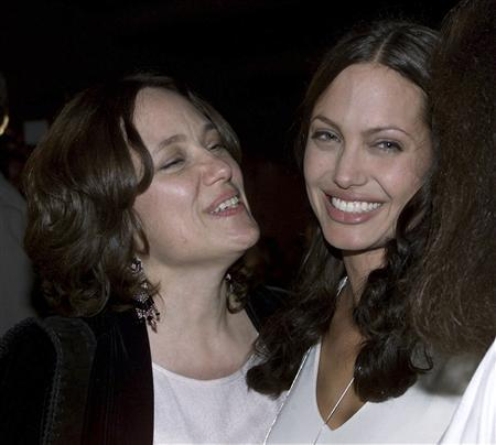 Actress Angelina Jolie (R) and her mother Marcheline Bertrand pose together at the premiere of Jolie's film ''Original Sin'' in Hollywood in this July 31, 2001 file photo. REUTERS/Fred Prouser/Files