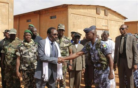 Mali's interim President Dioncounda Traore meets with Togolese troops, part of African-led International Support Mission in Mali (AFISMA), during his visit to their base in Mopti, May 4, 2013. REUTERS/Adama Diarra