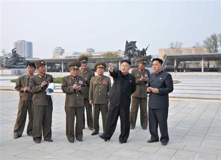 North Korean leader Kim Jong-un (2nd R) speaks during a visit to a construction site of the North Korean army, in this picture released by North Korea's KCNA news agency May 7, 2013. REUTERS/KCNA
