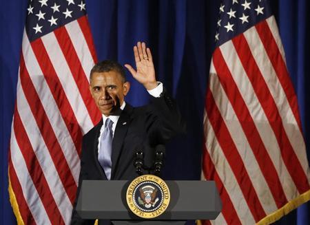 U.S. President Barack Obama waves as he steps off stage after speaking at a Democratic Party fundraiser at the Waldorf Astoria hotel in New York, May 13, 2013. Obama attended several fundraisers in Manhattan on Monday. REUTERS/Jason Reed