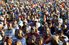 The mining community looks on as they are addressed by their leaders during a strike at Lonmin's Marikana platinum mine in Rustenburg, 100 km (62 miles) northwest of Johannesburg, May 14, 2013. REUTERS/Siphiwe Sibeko