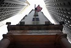 The U.S. flag hangs outside the New York Stock Exchange November 9, 2011. REUTERS/Brendan McDermid