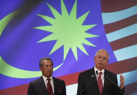 Malaysia's Prime Minister Najib Razak (R) speaks as his deputy Muhyiddin Yassin listens during the announcement of the new cabinet ministers lineup at his office in Putrajaya outside Kuala Lumpur May 15, 2013. REUTERS/Bazuki Muhammad