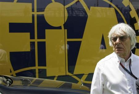 Formula One supremo Bernie Ecclestone looks on at a paddock before the qualifying session at the Spanish F1 Grand Prix at the Circuit de Catalunya in Montmelo, near Barcelona May 11, 2013. REUTERS/Gustau Nacarino
