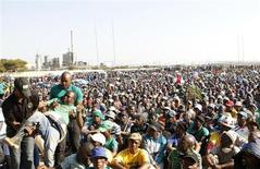 An unruly AMCU member (L) is removed from a gathering as other members are addressed by their leaders during a strike at Lonmin's Marikana platinum mine in Rustenburg, 100 km (62 miles) northwest of Johannesburg, May 15, 2013. REUTERS/Siphiwe Sibeko