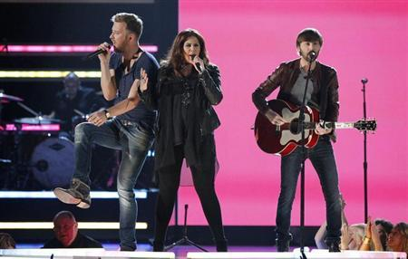 Charles Kelley (L), Hillary Scott and Dave Haywood of Lady Antebellum perform the song ''Downtown'' during the 48th ACM Awards in Las Vegas April 7, 2013. REUTERS/Mario Anzuoni
