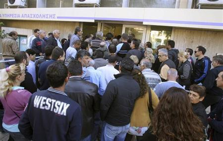 People wait for their turn to register for unemployment benefits at a local jobs centre in Nicosia April 23, 2013. REUTERS/Andreas Manolis