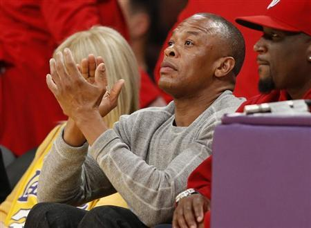 Recording artist Dr. Dre (C) attends the NBA basketball game between the Los Angeles Lakers and the Dallas Mavericks in Los Angeles April 2, 2013. REUTERS/Danny Moloshok