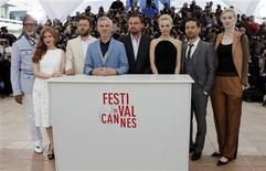 From L to R: Cast members Amitabh Bachchan, Isla Fisher, Joel Edgerton, director Baz Luhrmann, cast members Leonardo DiCaprio, Carey Mulligan, Tobey Maguire and Elizabeth Debicki pose during a photocall for the film 'The Great Gatsby' before the opening of the 66th Cannes Film Festival in Cannes May 15, 2013. REUTERS/Eric Gaillard