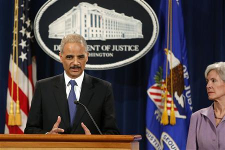 U.S. Attorney General Eric Holder (L) and Health and Human Services Secretary Kathleen Sebelius hold a news conference to announce Medicare Fraud Strike Force law enforcement actions at the Justice Department in Washington, May 14, 2013. REUTERS/Jonathan Ernst