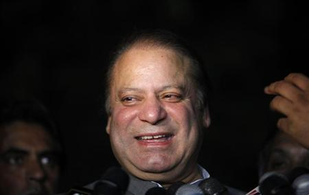 Nawaz Sharif, incoming prime minister and leader of political party Pakistan Muslim League-Nawaz (PML-N), smiles as he talks to journalists after visiting Imran Khan, Pakistani cricketer-turned-politician and chairman of political party Pakistan Tehreek-e-Insaf (PTI), outside the Shaukat Khanum hospital in Lahore May 14, 2013. REUTERS/Mohsin Raza