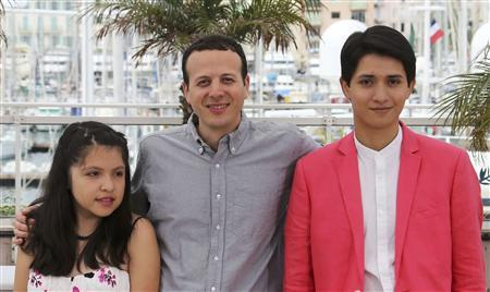 Director Amat Escalante (C) poses with cast members Armando Espitia (R) and Andrea Vergara during a photocall for the film 'Heli' during the 66th Cannes Film Festival in Cannes May 16, 2013 REUTERS/Regis Duvignau