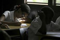 Students take a year-end math test at the Manuel Bisbe high school in Havana June 26, 2008. REUTERS/Enrique De La Osa