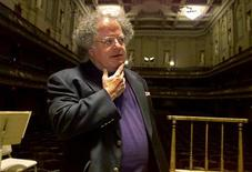James Levine pauses as he looks over the stage and conductor's podium in Boston's Symphony Hall after being announced as the next conductor and music director of The Boston Symphony Orchestra October 29, 2001 at a news conference in Boston. REUTERS\Jim Bourg