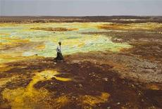 A man walks on sulphur and mineral salt formations near Dallol in the Danakil Depression, northern Ethiopia April 22, 2013. REUTERS/Siegfried Modola